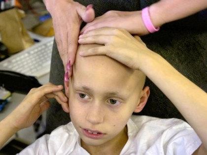 Ученые будут бороться с детским раком с помощью иммунотерапии и адресного лечения // Global Look Press