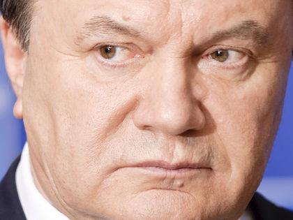 Если сейчас Янукович стал не президентом, это означает, что он оставался президентом? //  Global Look