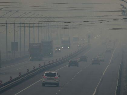 Туман и запах гари в столичном регионе сохранятся еще несколько суток // Global Look Press