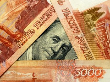Сразу несколько прогнозов о том, что в 2017 году рубль укрепится до 50–55 рублей за доллар, появились в январе // Global Look Press