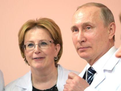 Вероника Скворцова и Владимир Путин в одной из инспекционных поездок // Global Look Press