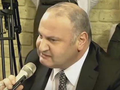 Экс-чиновник Эраст Матаев, избивший девушку на Арбате // YouTube