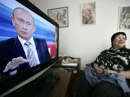 Владимир Путин на экране телевизора // Global Look