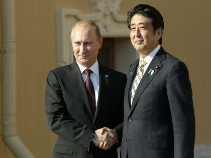 Президент РФ Владимир Путин и премьер-министр Японии Синдзо Абэ //  Russian Look