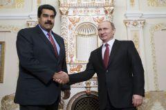 Владимир Путин и глава Венесуэлы Николас Мадуро, который пока поддерживает Россию