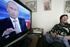 Владимир Путин на экране телевизора