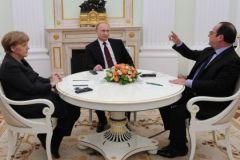 Советники Путина рекомендуют ему согласиться с планом Меркель и Олланда