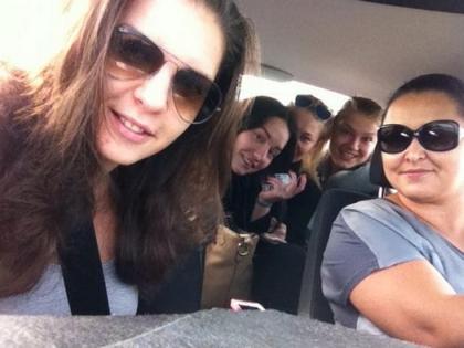 Алина Henessy (слева на фото) с коллегами в рабочей поездке