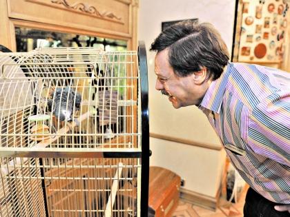 Михаил Барщевский с попугаем