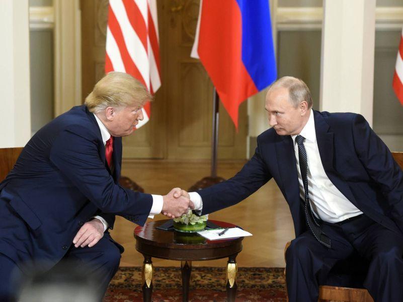 Президент США Дональд Трамп и президент РФ Владимир Путин на саммите в Хельсинки 16 июля // фото: Lehtikuva / Heikki Saukkomaa / Global Look Press